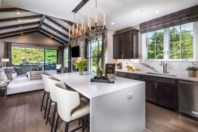 Home of the Week: This model in Millis boasts all the bells, whistles — and bars